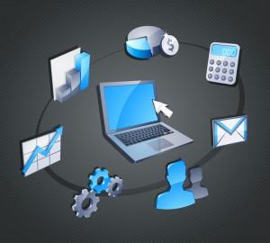 Un ordinateur entouré par des graphiques de gestion