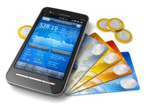 Un smartphone et des cartes de crédit